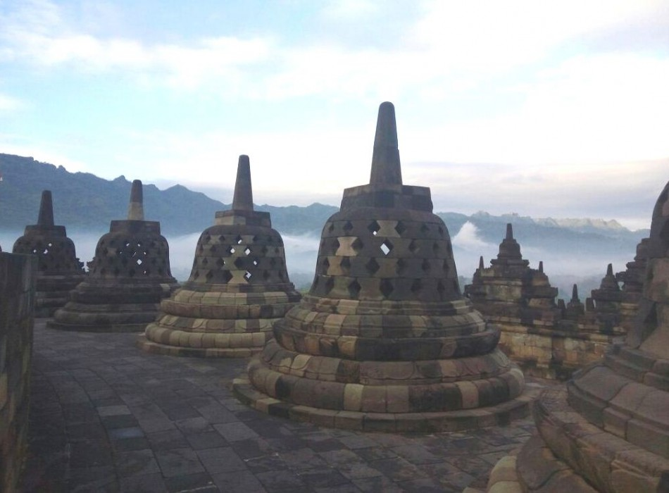Sunrise from Punthuk Setumbu Hill overlooking Borobudur Temple and Mount Merapi